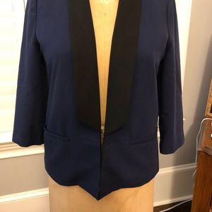 Blue jacket with a black label